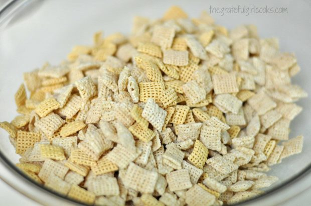 The different crispy cereals for muddy buddies are placed into a large bowl.