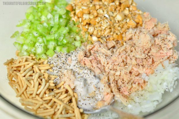 Celery, tuna, cashews, chow mein noodles in bowl for casserole