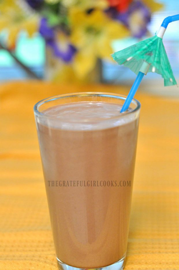 Creamy chocolate peanut butter smoothie, served with a tropical umbrella straw!