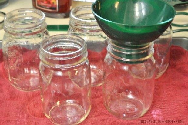 Sterilized, hot canning jars are ready for the beans to be added.