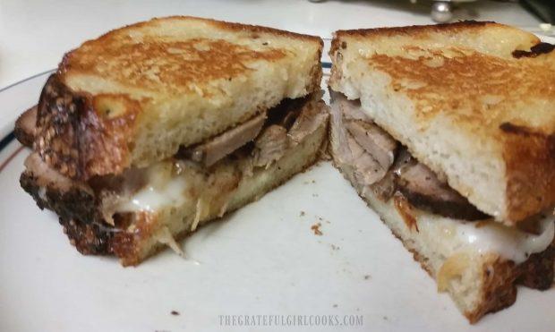 The grilled pork tenderloin sandwich, cut in half to serve.