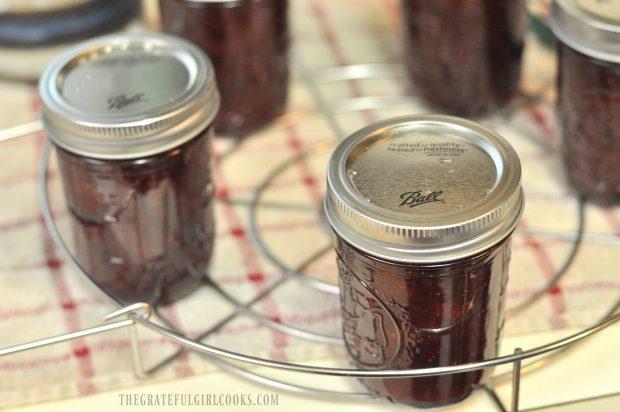 Jars of strawberry jam on canning rack