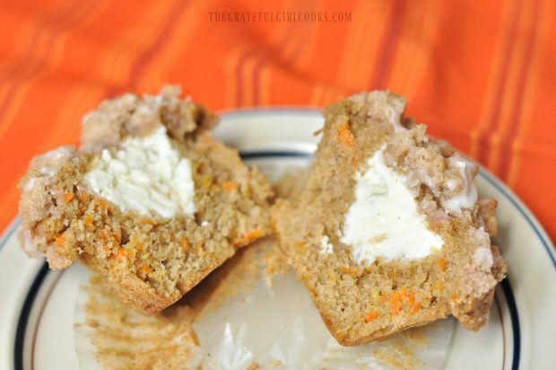 Inside of carrot cake muffin shows cream cheese filling