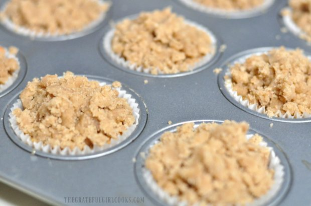 Streusel crumb topping added to muffin tops