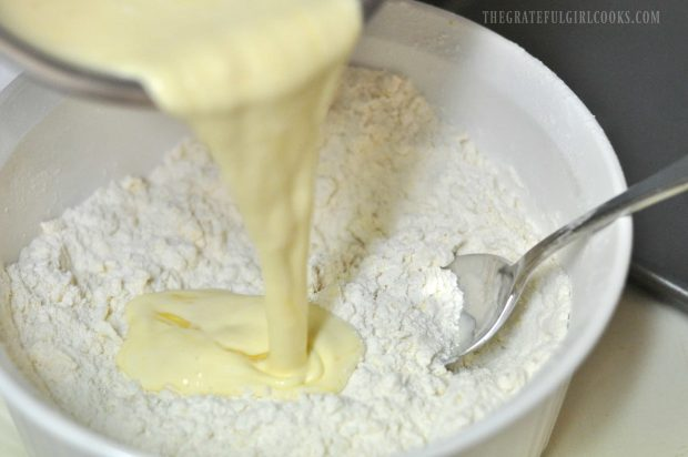 Egg and whipping cream are added to scone dough ingredients
