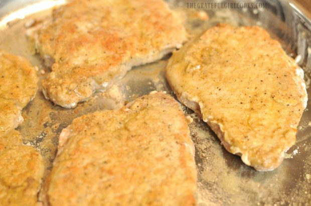 Cumin dusted pork cutlets are browned on all sides.