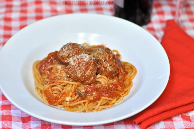 Easy meatballs for spaghetti are served in white bowl, and are ready to eat.