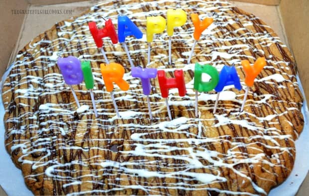The chocolate chip cookie pizza, decorated with chocolate icing, and birthday candles!