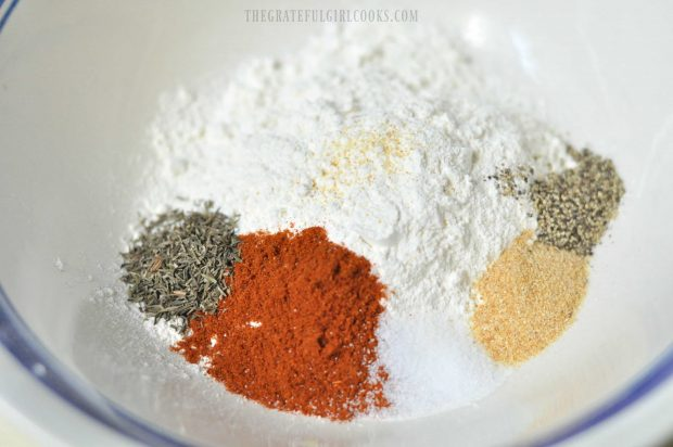 Spices are mixed together in bowl, for shake and bake chicken.