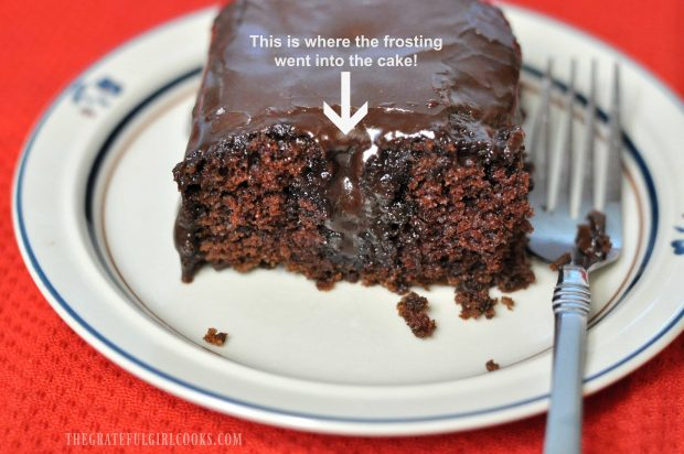 Piece of chocolate cake with frosting dripping through the middle