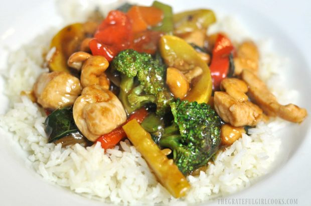 White rice serves as the bed for the chicken veggie stir fry.