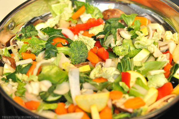 The veggies are cooked in a large skillet for the chicken veggie stir fry.