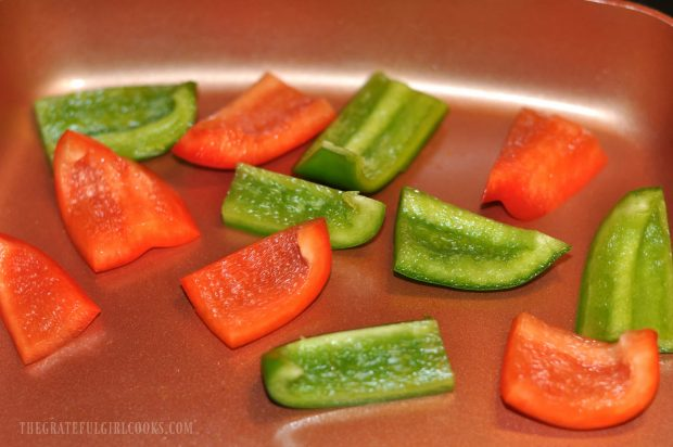 Red and green bell pepper chunks are pan-seared for kabobs