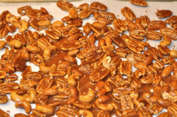 Maple cinnamon coated spiced nuts are spread out to bake