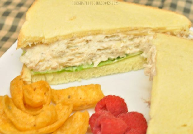 Chicken salad sandwiches, served with corn chips and raspberries