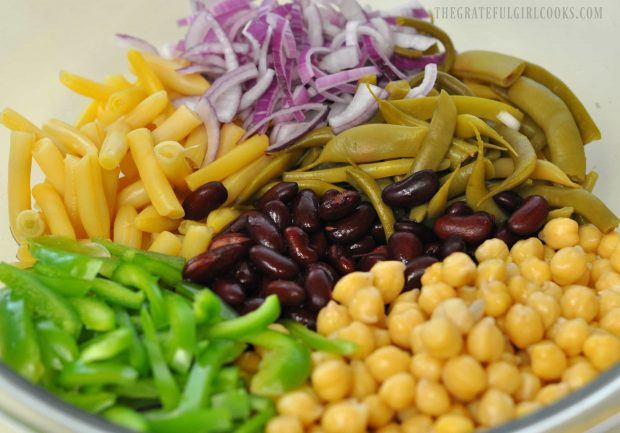 4 types of beans, with green pepper and red onion in bowl