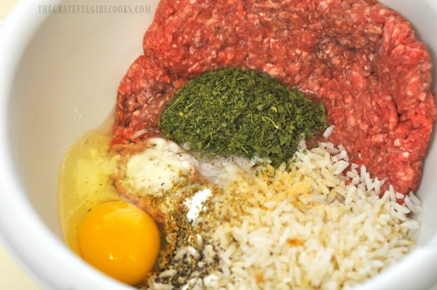 Meat, egg, spices for albondigas soup in bowl