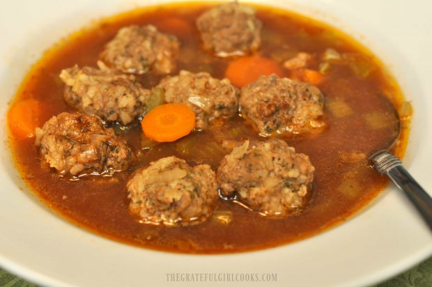 Bowl of soup with meatballs and carrots