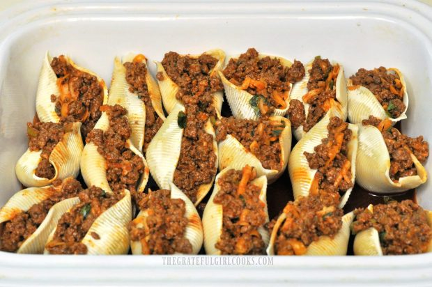 Mexican Stuffed Pasta Shells are arranged in dish before baking.