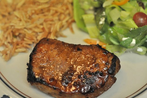 Honey garlic pork chops served with salad and toasted orzo side dish.