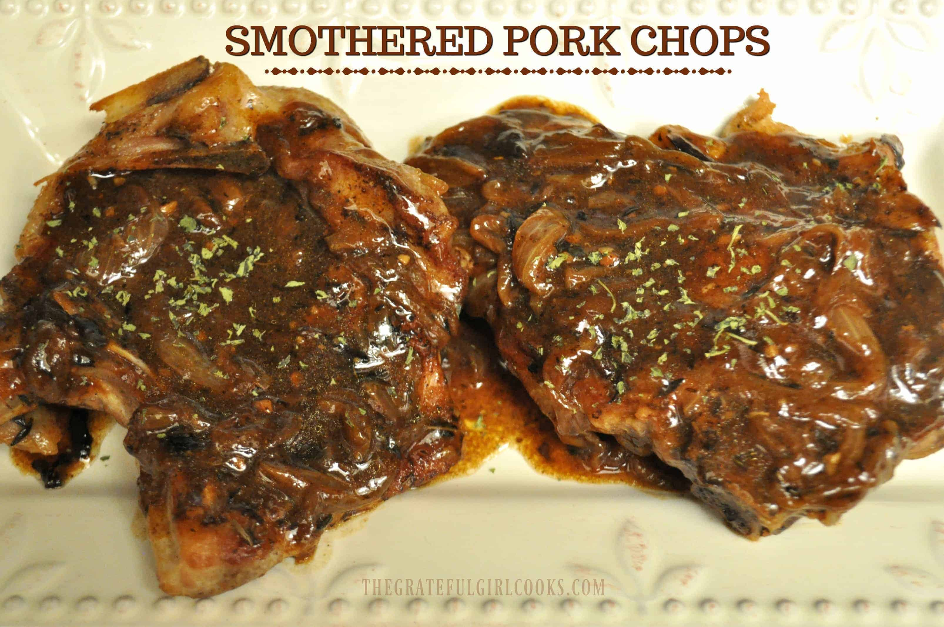 Smothered Pork Chops / The Grateful Girl Cooks! Pan-seared, bone-in pork chops... baked until tender, and smothered in a rich thick onion gravy.