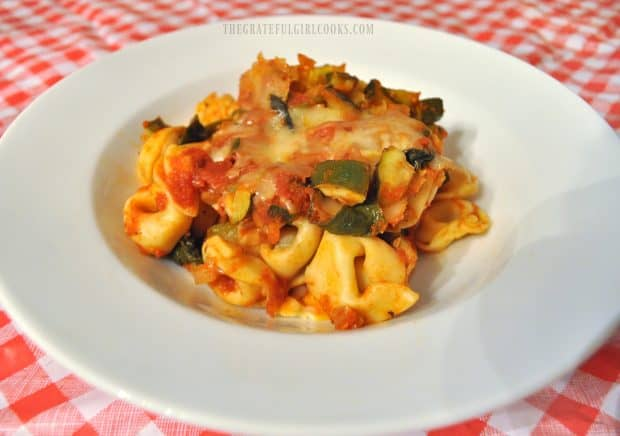 Tortellini and zucchini baked casserole in white serving bowl