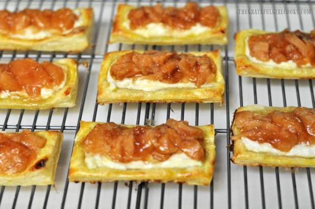 Apple cream cheese pastries are baked, then cool on a wire rack.
