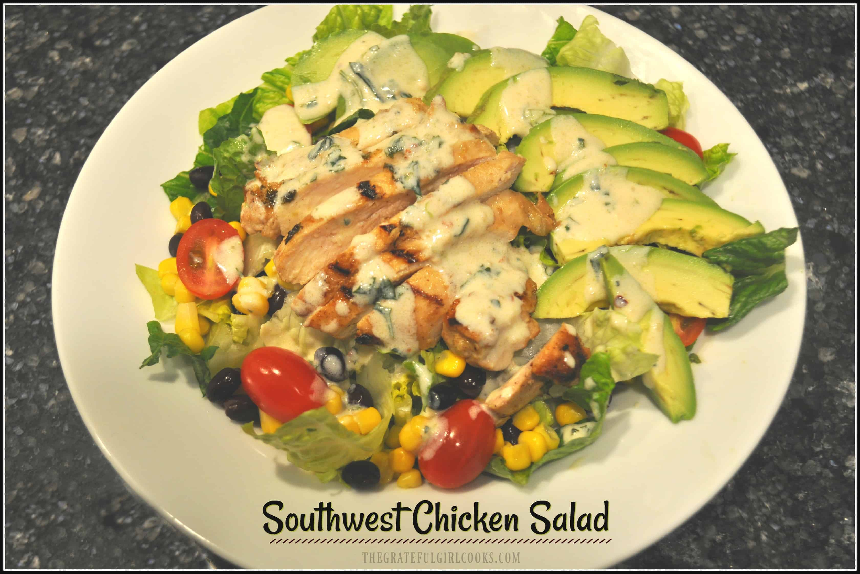 Southwest Chicken Salad / The Grateful Girl Cooks! You'll love this Southwest-inspired salad with marinated chicken, beans, corn, tomatoes, avocados, and lettuce, topped w/ a creamy lime cilantro dressing!