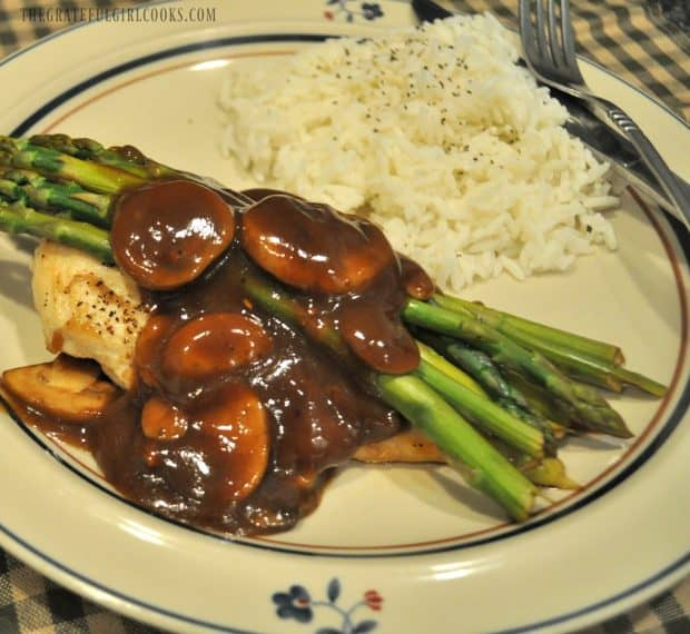 Balsamic Chicken, asparagus and mushrooms in sauce with rice, on plate