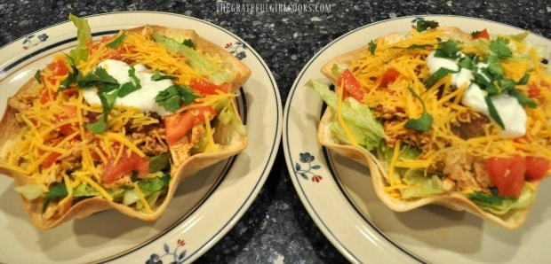 Two chicken taco salads on plates
