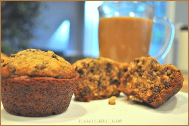 Inside look at banana espresso chocolate chip muffin with coffee behind it