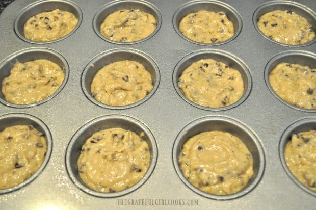 Muffin batter in metal muffin tin cup holders