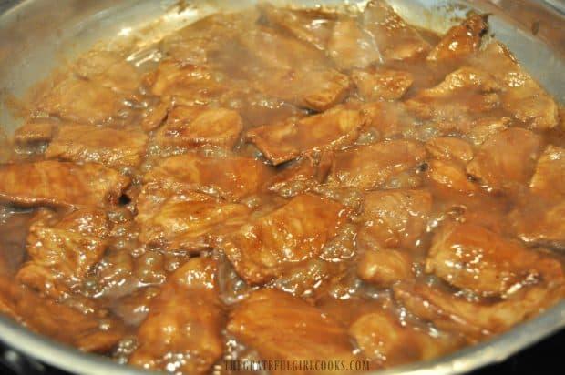 Hoisin pork cooking in large skillet