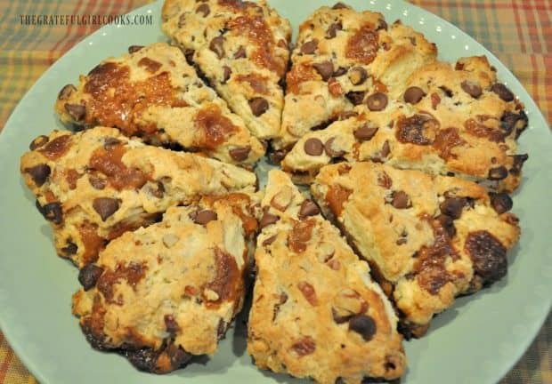 Baked chocolate caramel pecan scones on green serving plate