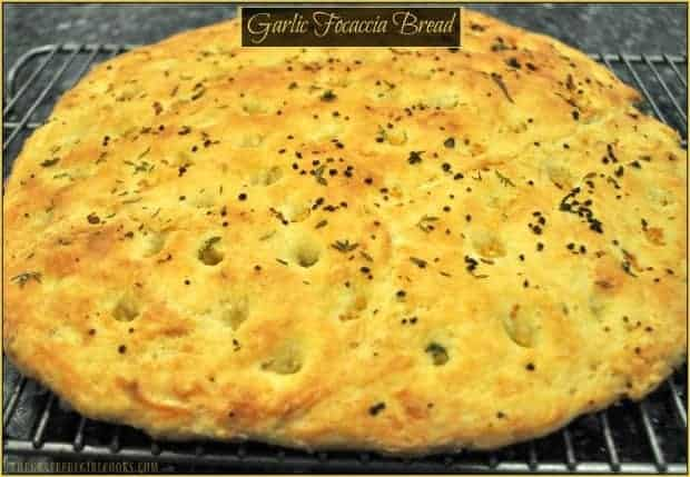 Garlic Focaccia Bread, with olive oil and fresh herbs, is a great side dish for a variety of meats and salads, can be served as an appetizer with dipping oil and herbs, or simply used to make sandwiches!