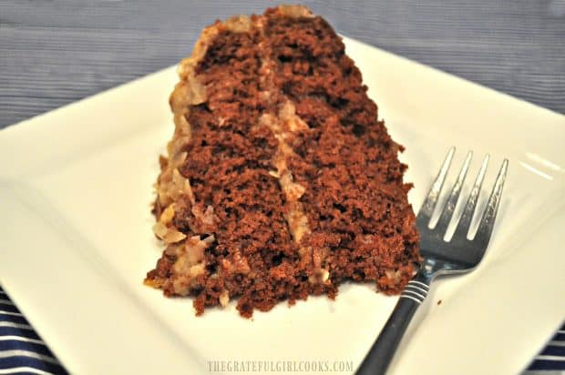 Easy German chocolate cake with homemade frosting on white plate