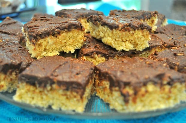 Platter of chocolate peanut butter krispy treats, on blue cloth