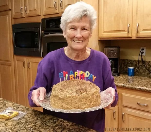 My mom, holding her birthday German Chocolate Cake