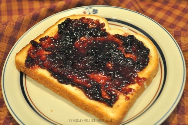 Toast with blackberry jam on a plate