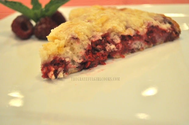 A slice of raspberry lemon crumb cake, served on a white plate