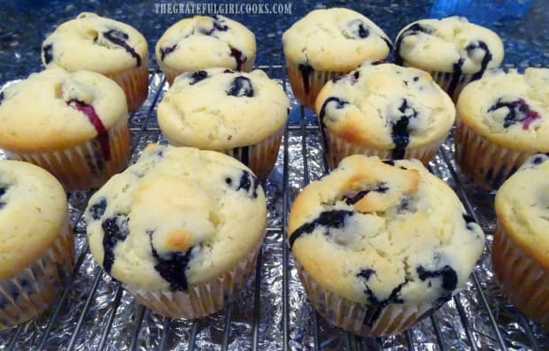 Baked blueberry lemon muffins, cooling on a wire rack.