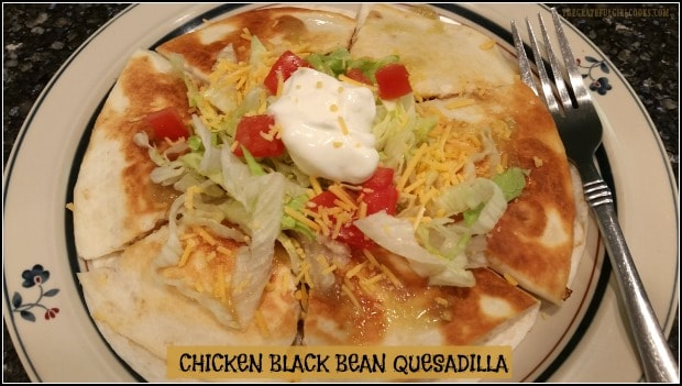 You'll love this easy grilled Chicken Black Bean Quesadilla with salsa verde, corn & cheddar cheese, served with lettuce, tomatoes and sour cream.