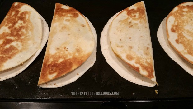Each chicken black bean quesadilla is turned to other side when golden brown during cooking.