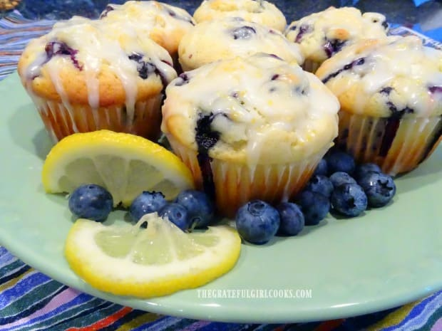 Blueberry lemon muffins are drizzled with lemon glaze and are ready to eat!
