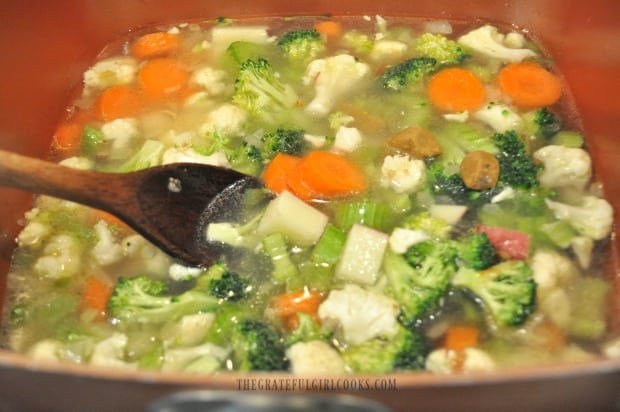 Vegetables for chowder cooked in chicken broth.