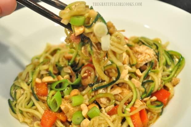 Chopsticks lifting up a bite of Kung Pao Zoodles!