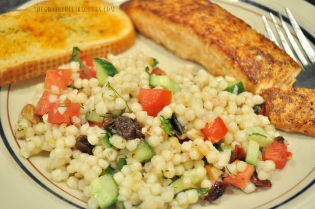 Lemon herb couscous salad is served with Creole salmon and garlic bread.