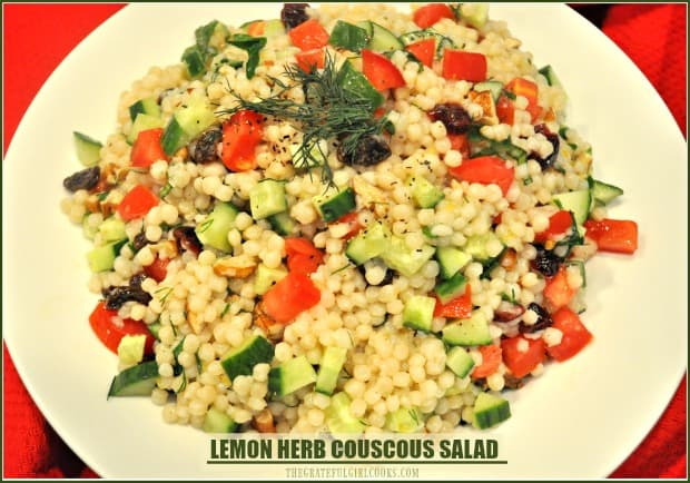 Lemon Herb Couscous Salad, w/ cucumbers, raisins, toasted pecans, dried cranberries, fresh herbs, tossed in a light lemon dressing is an easy, tasty side dish!