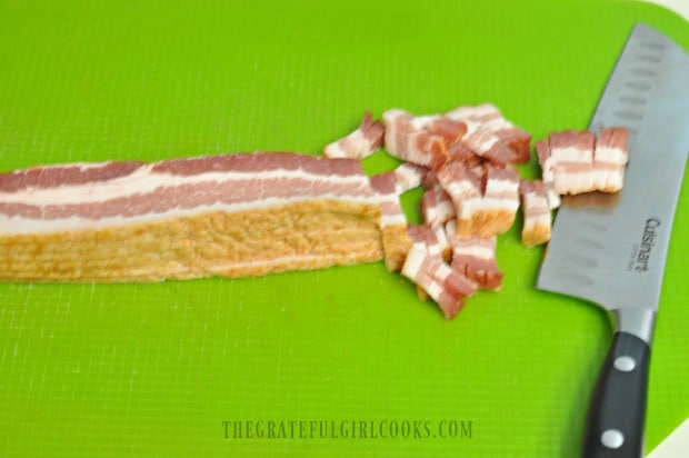 Slicing the bacon up thin to cook, in order to add to tortellini dish.