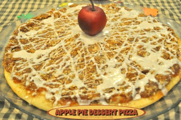 Apple pie dessert pizza features a thin pizza crust, topped with apple pie filling, a brown sugar and oats streusel topping, drizzled with cinnamon icing.